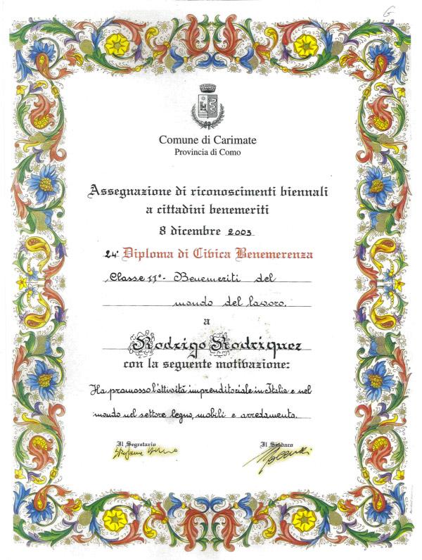 """Dicembre 2003 - diploma di Civica Benemerenza attribuito dal Comune di Carimate con la motivazione """" Ha promosso l'attività imprenditoriale in Italia e nel mondo nel settore legno, mobili e arredamento """""""